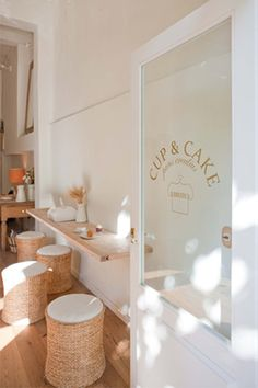 Cup & Cake in Barcelona. Gold forme cut door decal, stools, white, gold