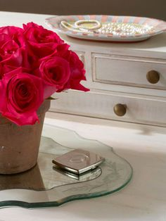 The little details make the bedroom, such as this bright pink bouquet of roses and a handpainted tray to hold jewelry: http://www.bhg.com/decorating/decorating-style/flea-market/old-meets-new-flea-market-finds/?socsrc=bhgpin030714littledetails&page=12