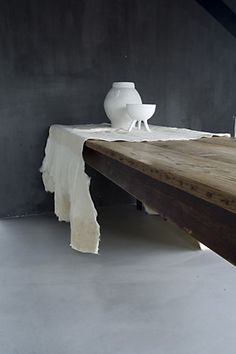 charcoal-gray walls. rustic-wood table.