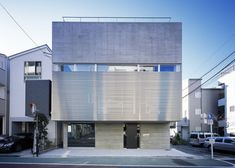 This concrete house in Tokyo was designed for a family that regularly accommodates foreign exchange students.