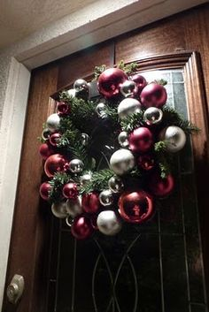 Wreath-make of Christmas red and silver balls for front door