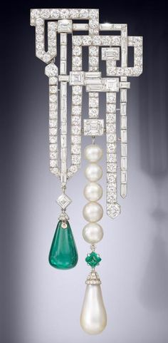 Larger pin of Van Cleef and Arpels breaks records and makes history. The brooch sold at Bonhams Bond Street, London for more than one million pounds. It features a typical Art Deco design set in different cut diamonds alternated in geometrical fashion and two very important drop pendants, an emerald and a natural pearl. The piece is huge and incredibly beautiful, undoubtedly one of the best examples of VCA Art Deco