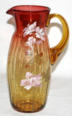 AMBERINA GLASS PITCHER WITH ENAMEL, C. 1870, H 11 1/4:Elongated body with ribbing, enameled flower sprays, polished pontil.