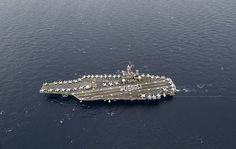 PHILIPPINE SEA (Sept. 29, 2013) Sailors aboard the aircraft carrier USS George Washington (CVN 73) stand in formation to spell out #USSGW on the flight deck.