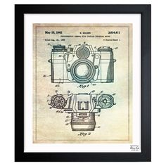 Inspired by authentic patent drawings, this handcrafted art print showcases an antique camera motif—making a perfect accent to flea market finds and vintag...