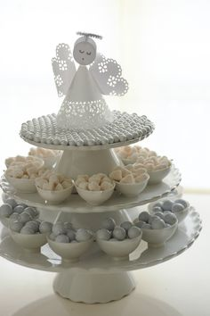 Three tiered sweets stand: Crate and Barrel cake stands, Martha Stewart for Macy's mini leaf dishes, Groovy Candy champagne bubbles and chocolate foil balls