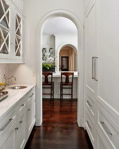 Tucked into hallway space. Design Chic: ThingsWeLove:ConcealedRefrigerators