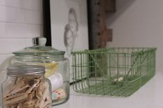 add glass jars with cute stuff to the shelves in the laundry room.