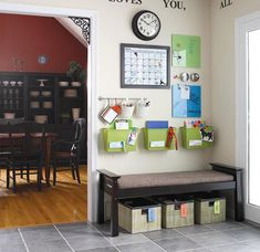 This #entryway clearly serves several functions. The clock, calendar and wall storage bins help this busy family keep #organized & informed. The baskets - color coded for each individual - are perfect for storing shoes, small bags and sweaters. The tile floor is also practical for an entryway in snow or beach terrains.
