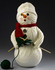 Sweater Snowman - Repurpose old socks, sweaters and more to create a cute snowman craft.