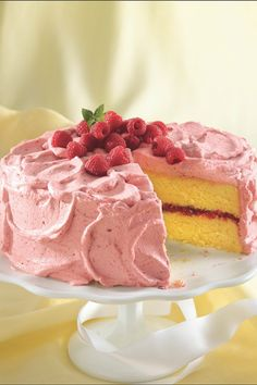 Lemon cake with raspberry filling and raspberry-whipped cream mousse frosting.