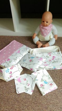 These are great little set for your little girls doll.  Each includes:  Two nappies Changing mat Two wipes One dribble bib Quilt Cushion Messanger