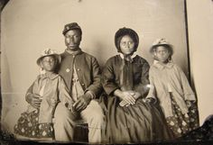 The only known photograph of an African American Union soldier with his family. c1863-65