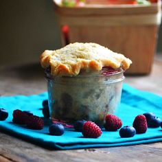 Raspberry Blueberry Rhubarb Pie in a Jar | Such a delightful way to end a county meal, these pies in a jar are adorable and almost too good to be true. @bakeaholic