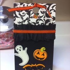 Halloween treat bags.  Super easy.  Scrapbook paper and ruffled crepe paper. Used stickers and ribbon for rest.
