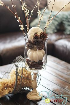White Pumpkin Center Piece-I like these better than the orange colored pieces for a fall wedding.
