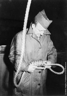 Master Sergeant John Wood of San Antonio, Texas, preparing a noose for a convicted Nazi war criminal. Sergeant Wood is the official hangman at the war trials. (Photo by Keystone/Getty Images). 19th November 1945