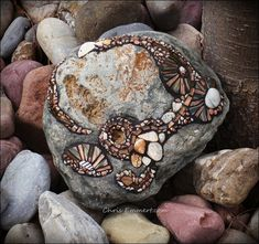 Shell and Pebble Mosaic Rock / Garden Stone - glass tile, tiny pebbles and shells - by Chris Emmert    Glass tile, tiny pebbles and shells.