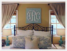 wooden monogram over bed