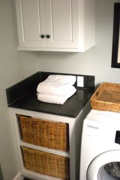 Laundry sorting baskets with cabinet above leading to a laundry shoot from the master bedroom closet   posted from: classic • casual • home: Visit My Home