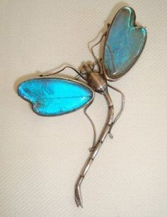 Sterling dragonfly with butterfly wing wings