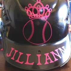 Custom batting helmet. She helped so the letters are a bit crooked. Last name is on the back. Great way to make big brother's old helmet girly!