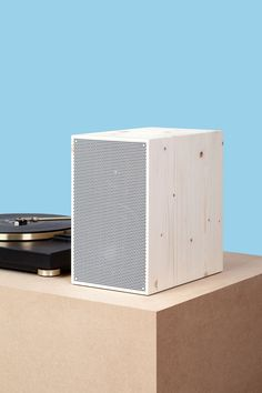 white wooded speakers