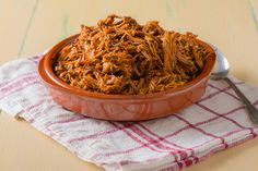 Slow Cooker BBQ Pulled Pork tastes just like the traditional recipe but we swapped out many of the high calorie processed ingredients for healthier, whole food options.  #slowcooker #crockpot #pulledpork
