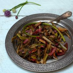 Sauteed chard with pomegranate sauce