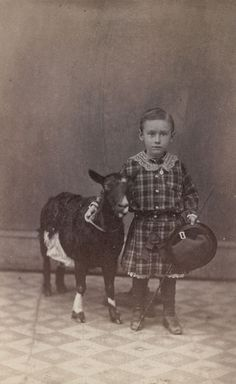 ca. 1865, [albumen portrait of a young boy with a goat], J.B. Gibson