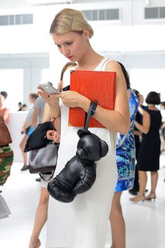 Bear plus boxing glove equals an eye-catching (or eye-blackening) #NYFW #accessory. (Photo: Casey Kelbaugh for The New York Times)