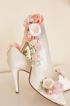 Flower adorned bridal shoes