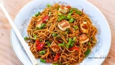 Spaghetti tossed with tomato sauce made of chilies, garlic, and soy sauce. Add the crispy, pan fried paneer at the end for delicious, salty bites.