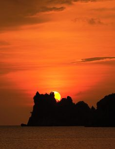 Langkawi is for lovers. A flaming Malaysian sky makes for the perfect honeymoon sunset.