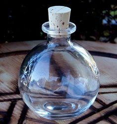 Crystal Clear Round Glass Corked Spell Potion Bottle 8 oz.. $6.95, via Etsy...fun for Skylander Pop Fizz party decorating