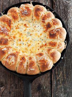 Warm Skillet Bread and Artichoke Spinach Dip – warm pull-apart rolls around a warm, creamy Artichoke Spinach dip.