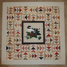 like the applique block in the middle surrounded by flying geese quilting life.com