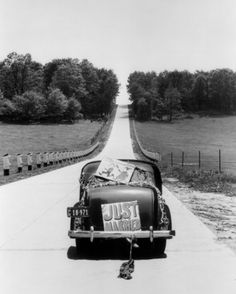 H. Armstrong Roberts - Back View Of Car With Just Married Sign, USA ca. 1930's. S)