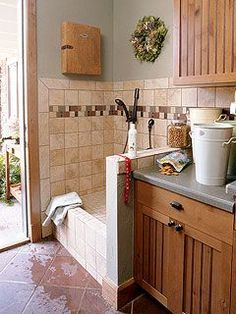 Great laundry room / mud room idea--that step up shower is awesome for muddy pets and yes...kids! :)