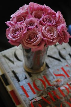 Fresh pink roses and the latest issue of Vogue...must-haves on every coffee table