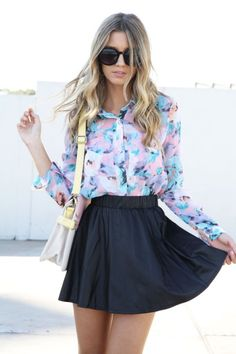 floral blouse with black skirt.