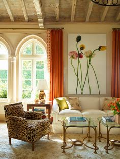 Well-designed room! Eye-catching art, drapery, and tables.