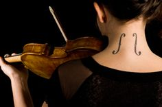 An interesting way to show your dedication.  Violin F-holes Tattoo