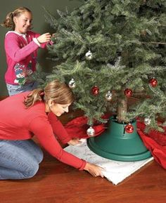 Holiday tip: Put a bath rug underneath the tree stand (rubber side up) for easy tree rotation. This makes hanging ornaments really easy - no more stretching or reaching around the tree!