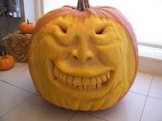 A toothy smile happy pumpkin carving  Here's a fun carved jackolantern