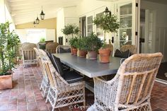 love the wicker chairs with the zinc topped table - classic • casual • home