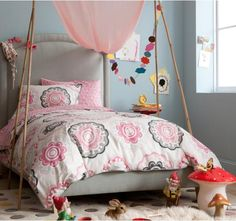 If Ella would go for it, I'd love this comforter and wall color for her room.