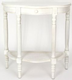 Beveled Doric Console Table - White by ORIENTAL FURNITURE. $309.00. Antiqued white console table in a semi-circle shape to stand flush with the wall. Classic European design, with Queen Ann style scalloped, beveled top. Shallow bentwood center drawer, with round wood pull. Block and bobbin design at the top of the legs, with block and baluster design at the bottom. Scalloped-frame woven caning shelf reinforces the legs and offers practical display space for a plant or curio.