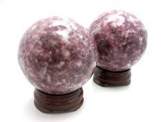 """Lepidolite aids in overcoming any kind of emotional or mental dependency, supporting in the release of addictions.  It encourages independence and self love.    Lepidolite clears EMF.  Strengthens the immune system, soothes the nervous system and can be used to restructure DNA.   It can relieve allergies and greatly help with epilepsy and Alzheimers.  It numbs sciatica and neuralgia, and overcomes joint problems.  It treats illnesses caused by """"sick-building syndrome"""" or computer stress."""