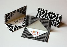 Aren't these cute business cards holders made out of origami?    There is a how to make them out of clear plastic, paper, and fabric...too cool.